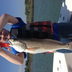 Kids Fishing big Red Drum