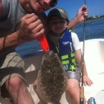His First Flounder! - Wilmington Fishing Charters